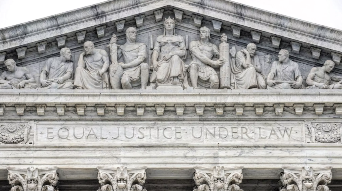 Carved statues into a building that says Equal Justice Under Law