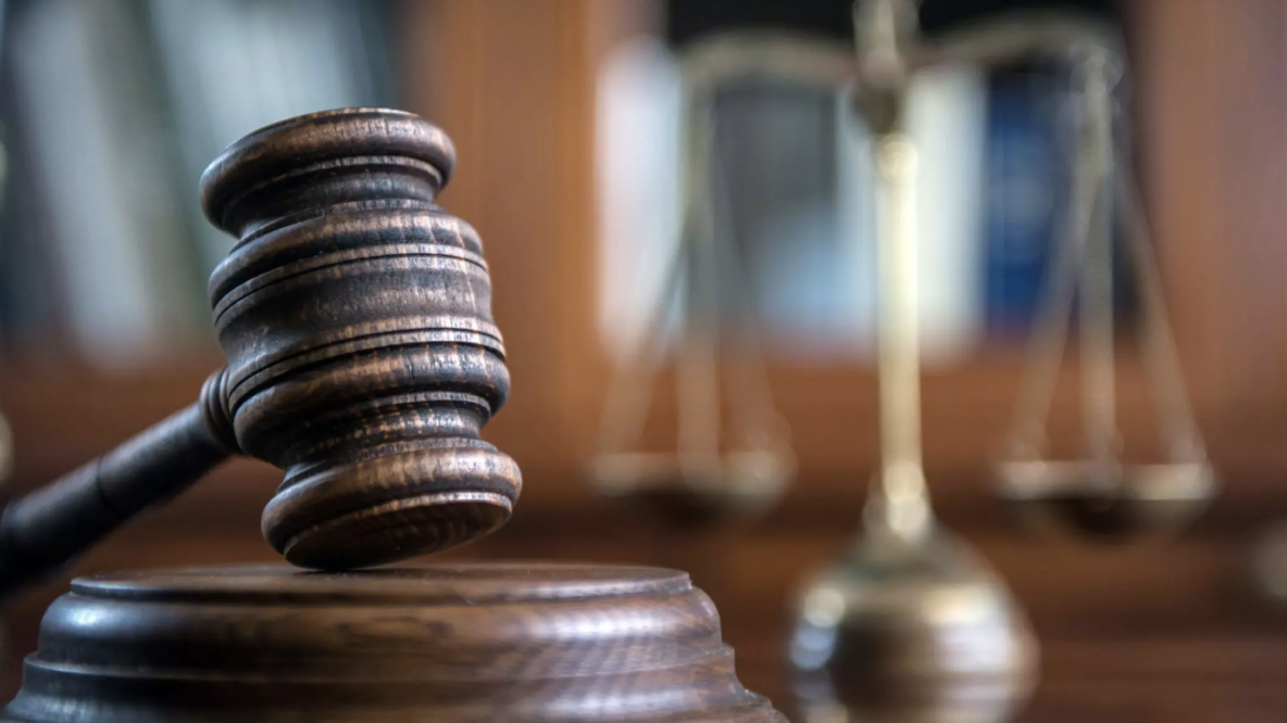 Gavel in front of scales