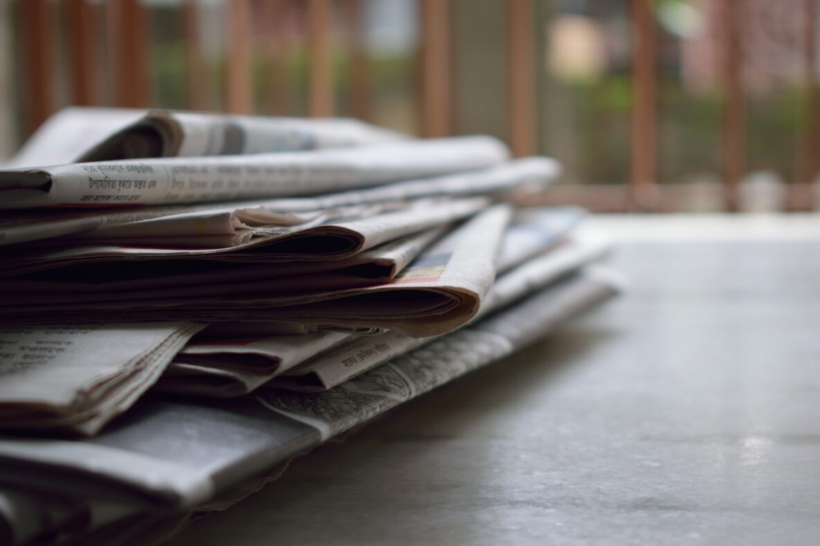 Photo: stacked newspapers